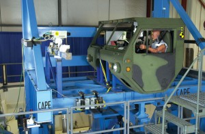 The cab of a military vehicle sits waiting to test occupant performance on CAPE's rollover machine.