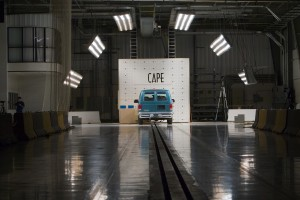 A van is shown ringed by bright lights as it nears impact with CAPE's barrier block.
